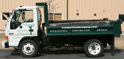 A Cooper Landscaping mini dump truck