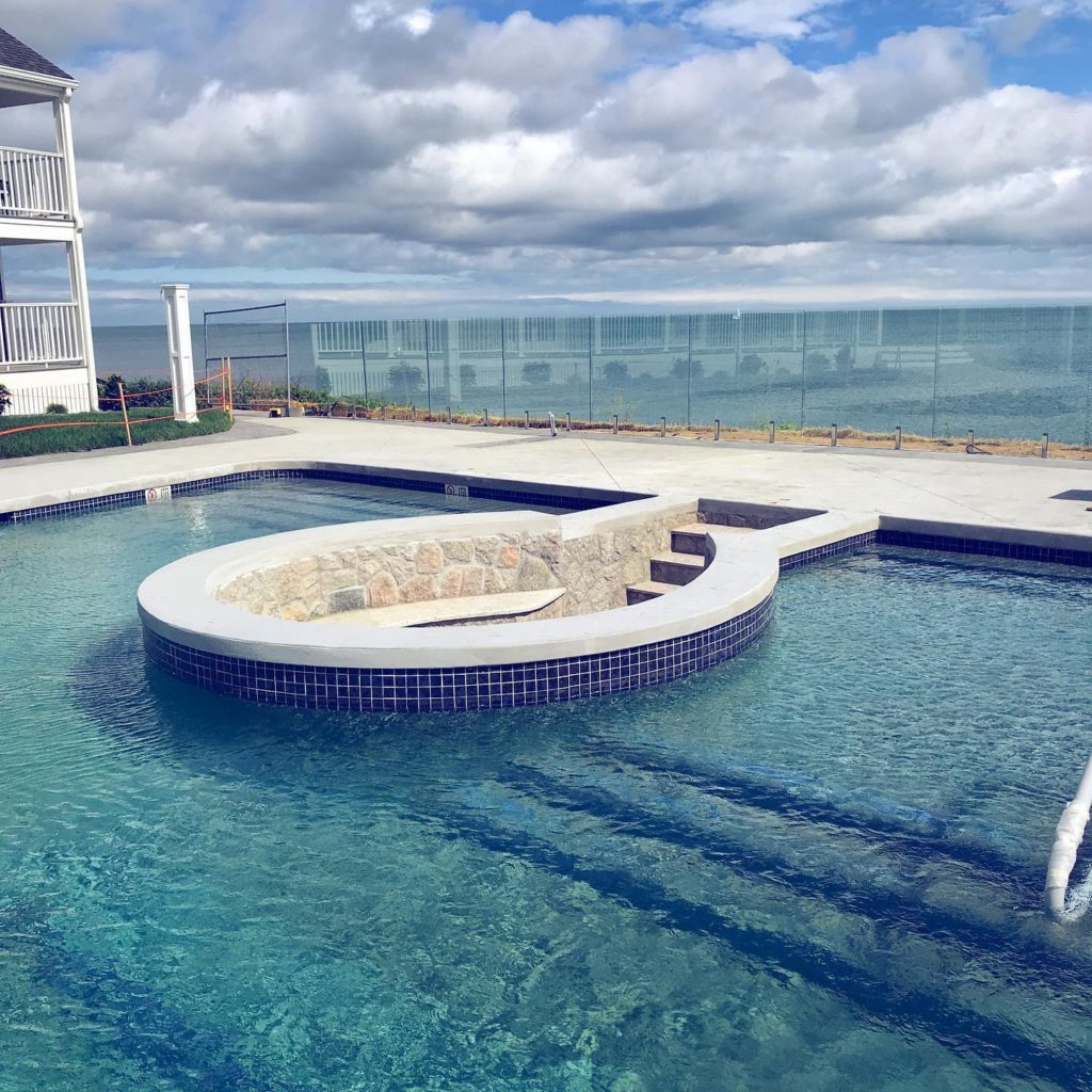 A pool with circular inset seating area constructed by Cooper Landscaping